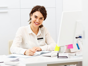 Smiling woman at a desk